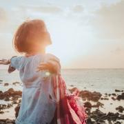 woman on the shore - sun shining